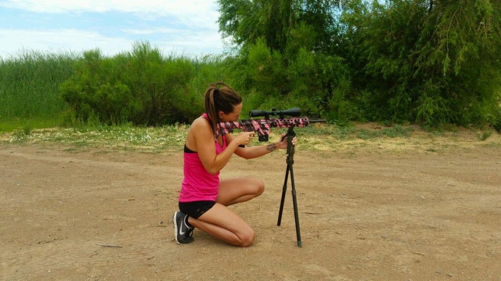Girl shooting pink gun at Lower Sand Cove Reservoir near Gunlock, Utah