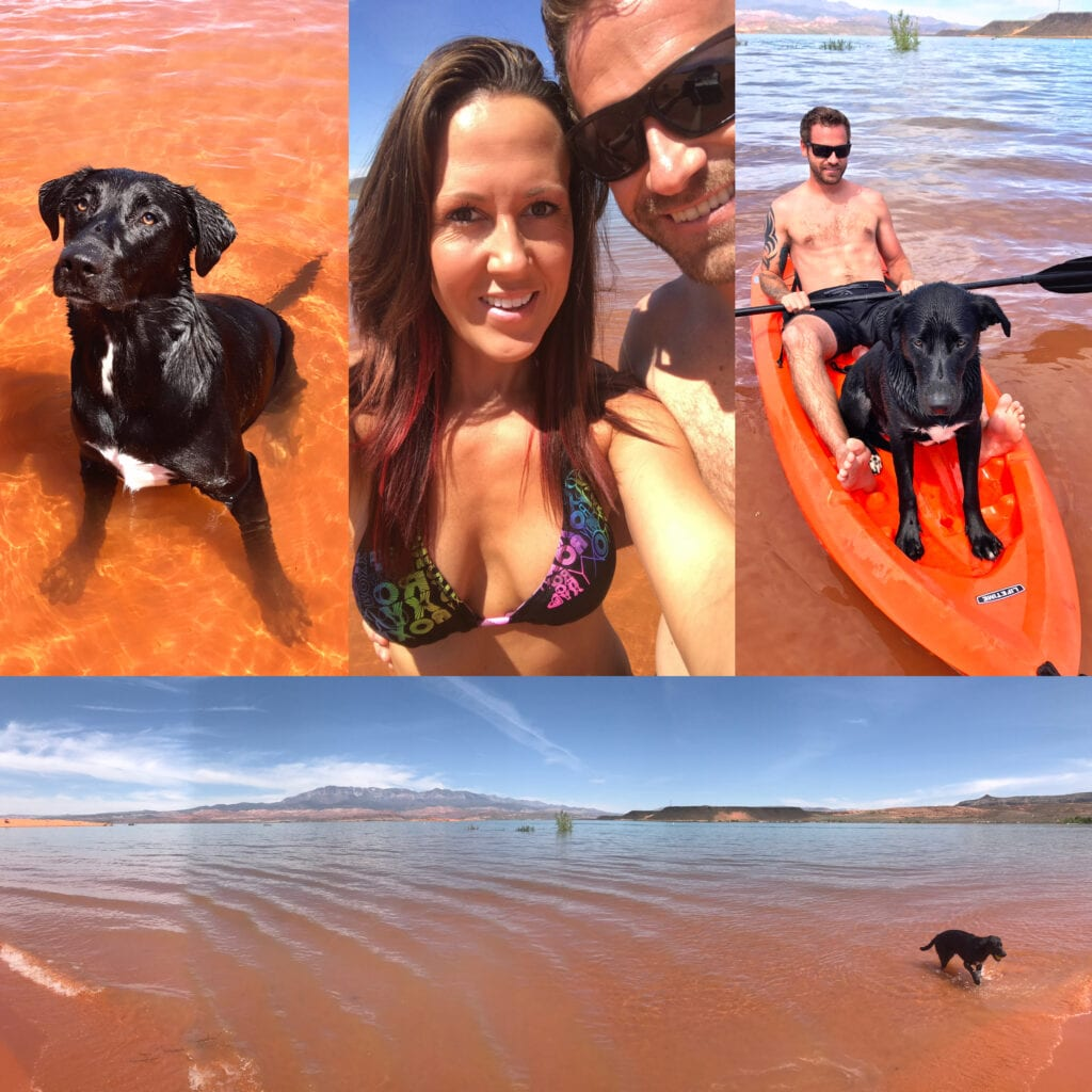 Man and women enjoying Sand Hollow State Park Reservoir with black lab. Kayaking and swimming