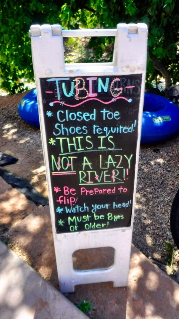 "Tubing Sign: ""Closed toe shoes required. THIS IS NOT A LAZY RIVER. Be prepared to flip, watch your head, must be 8 years old or older."""