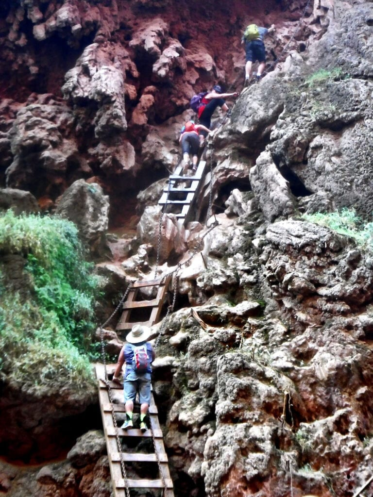 Ladder with people climbing Mooney Falls The Grand Canyon, Arizona