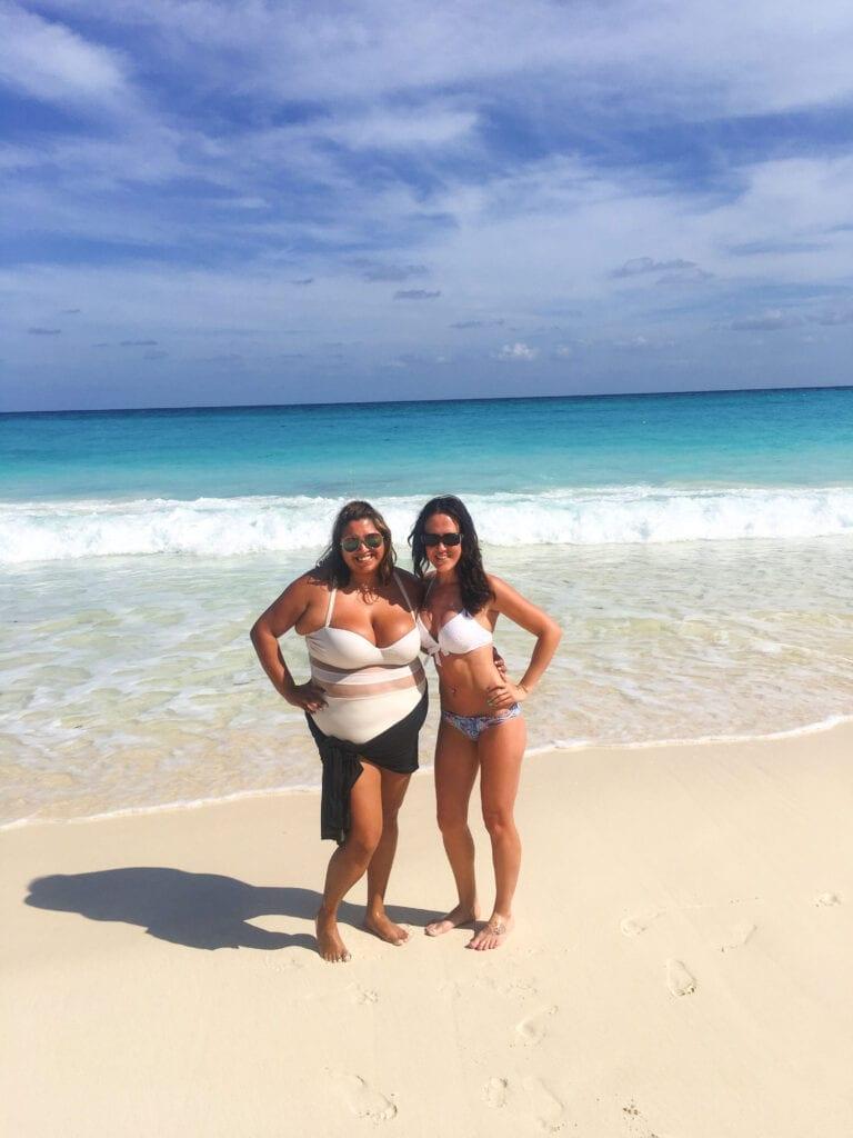 Girls in bikinis posing on the beach in Cancun, Mexico