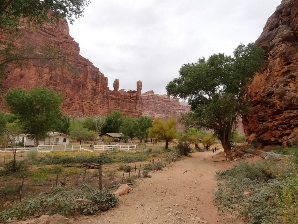 Supai Indian Reservation path with moutains against the sky with trees