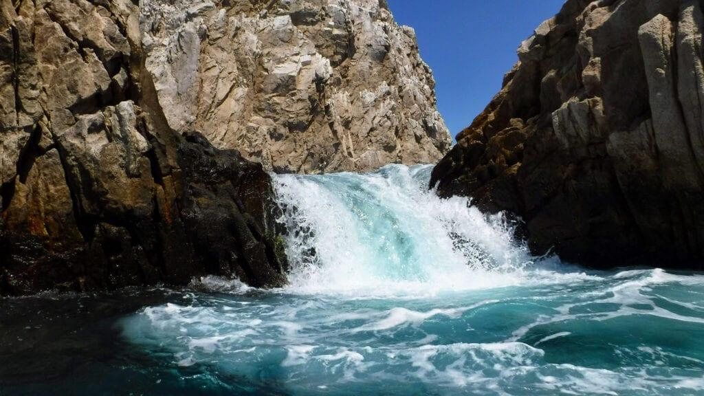 waterfall into the ocean Cabo San Lucas, Mexico