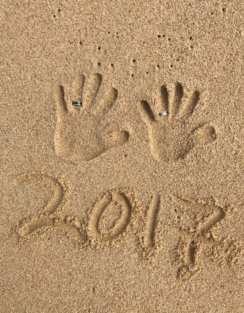 creative beach shot the Rui Hotel and Resort, Cabo San Lucas, Mexico  2 hand prints in the sand with wedding rings, honeymoon vacation, year 2017