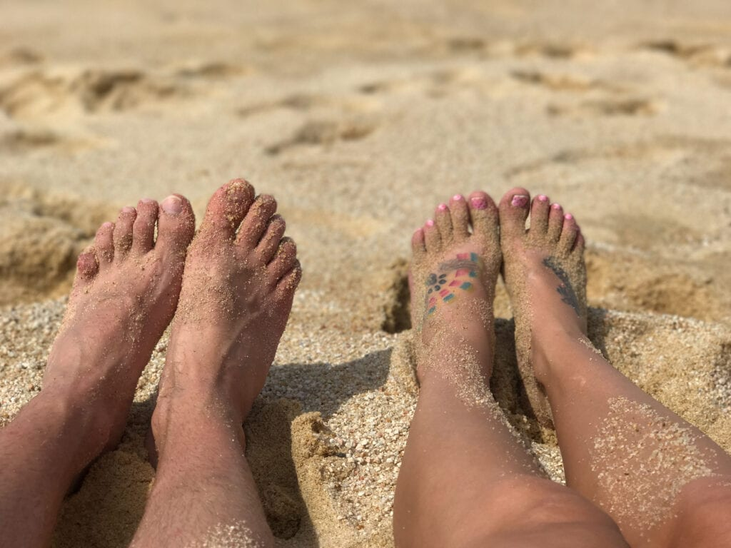 toes in the sand man and woman at the Rui Hotel and Resort, Cabo San Lucas, Mexico