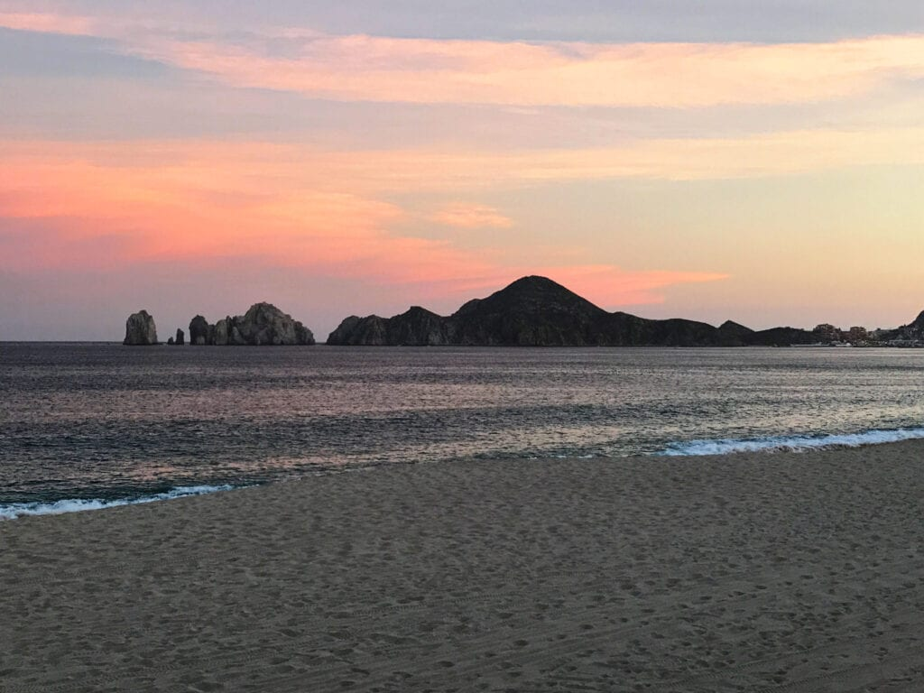 sunset shot of the beach, sky against the mountains and ocean the Rui Hotel and Resort, Cabo San Lucas, Mexico