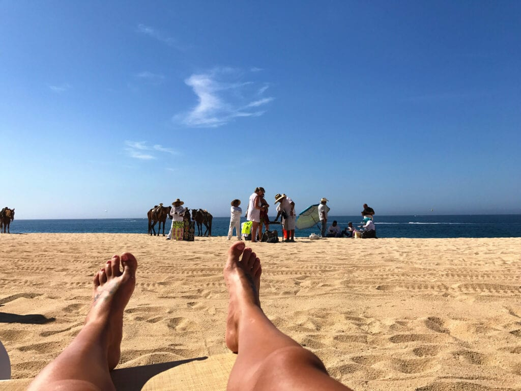 girls legs facing the ocean, relaxing at the Rui Hotel and Resort, Cabo San Lucas, Mexico