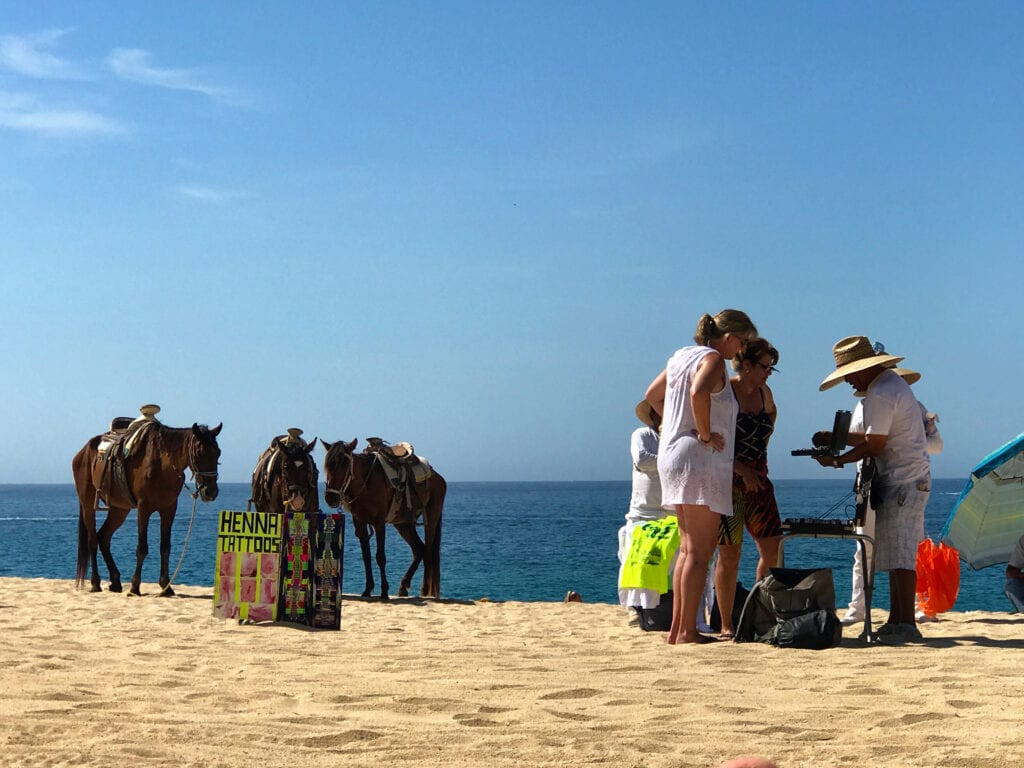 People selling goods on the beach at the Rui Hotel and Resort, Cabo San Lucas, Mexico