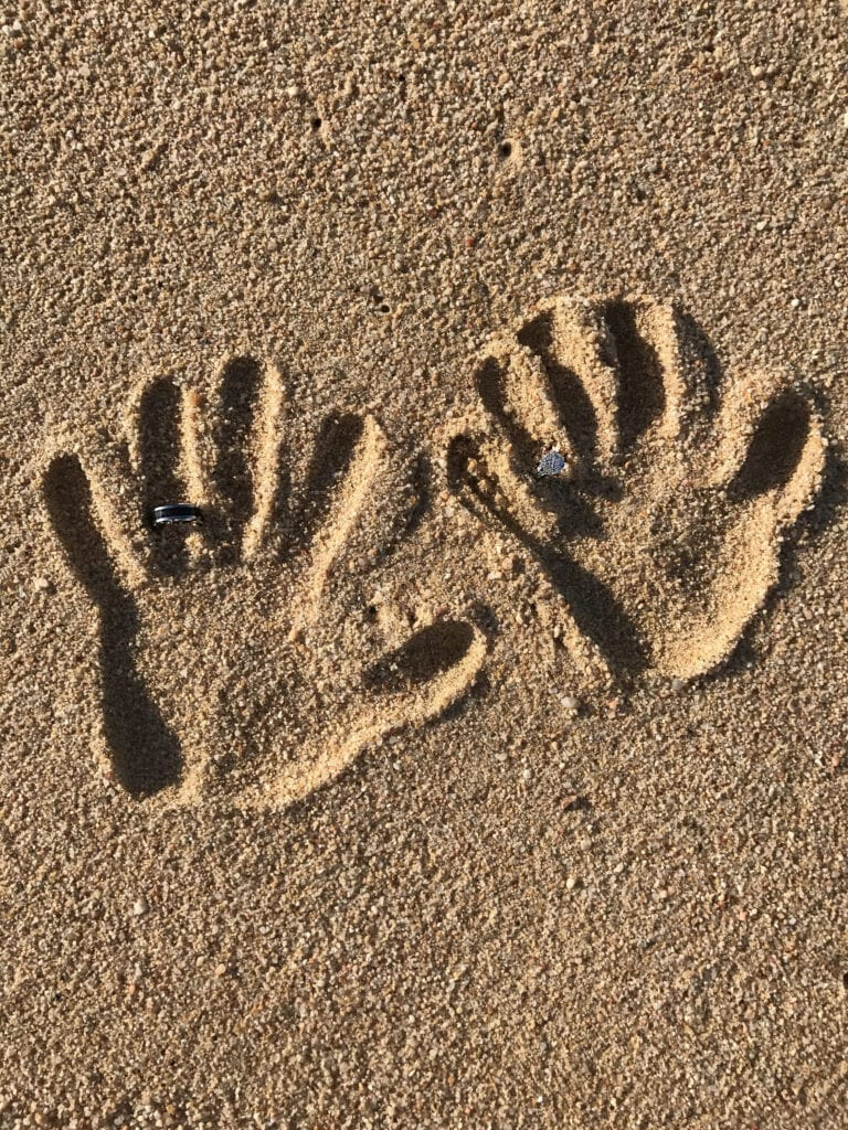 creative beach shot the Rui Hotel and Resort, Cabo San Lucas, Mexico  2 hand prints in the sand with wedding rings, honeymoon vacation