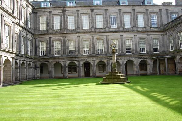 THE PALACE AT HOLYROOD PLACE, castle against the green grass