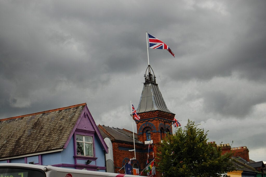 Moody shot of the flag in Ireland against the rainy sky