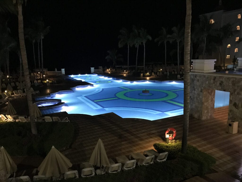 View of the pool illuminated at night he Rui Hotel and Resort, Cabo San Lucas, Mexico