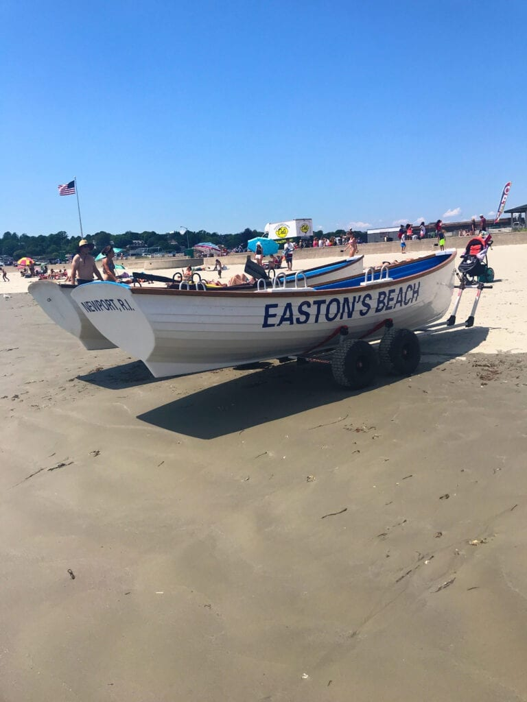 "Boats on shore that read ""Easton's Beach"" on the side in Newport Rhode Island"