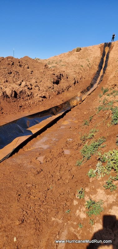 make shift mud slide made in the desert for event