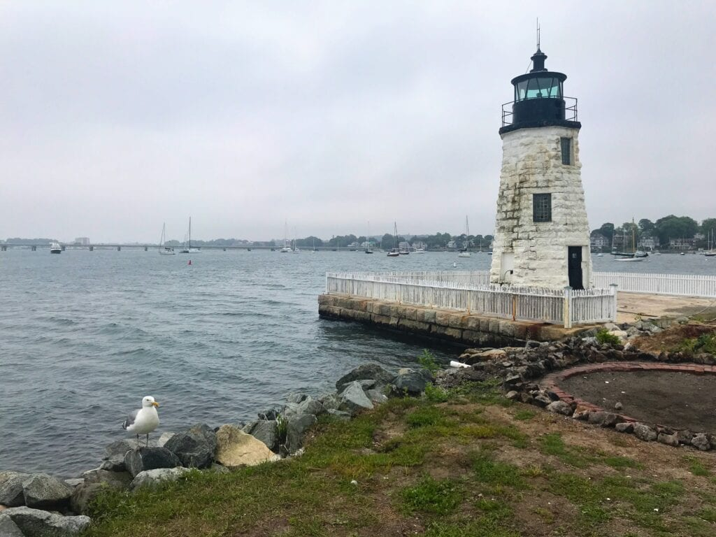 View of the Newport Harbor Light overlooking the ocean on an overcast day
