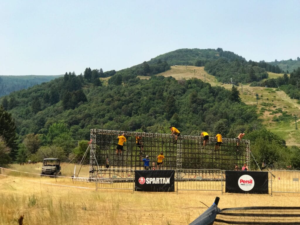 Spartan Race obstacle with people climbling