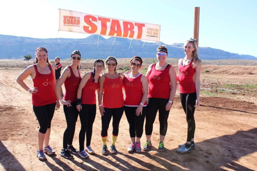 Girl's team posing in front of Start line at race