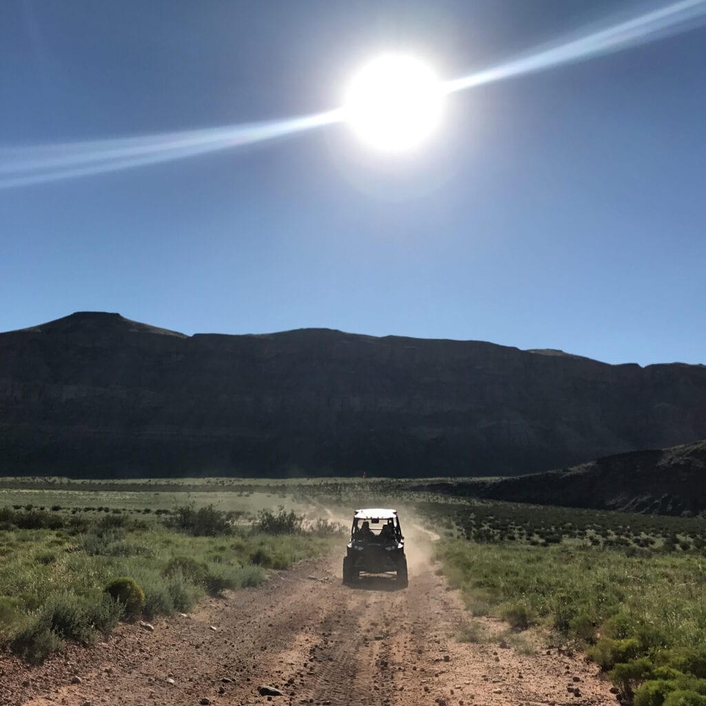 photo of ATV on dirt road going to Sand Hollow sand dunes, utah