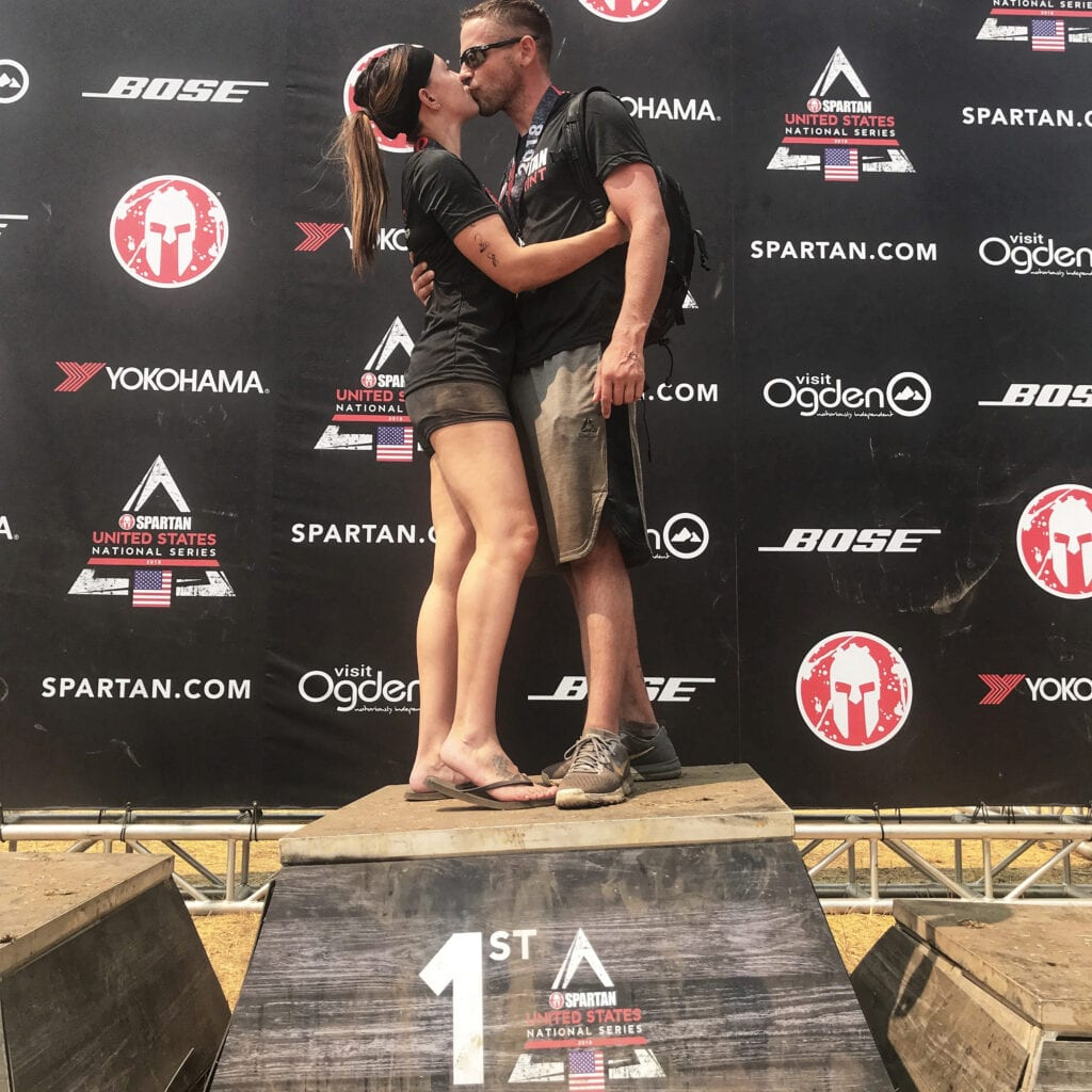 Man and woman kissing at Spartan Race