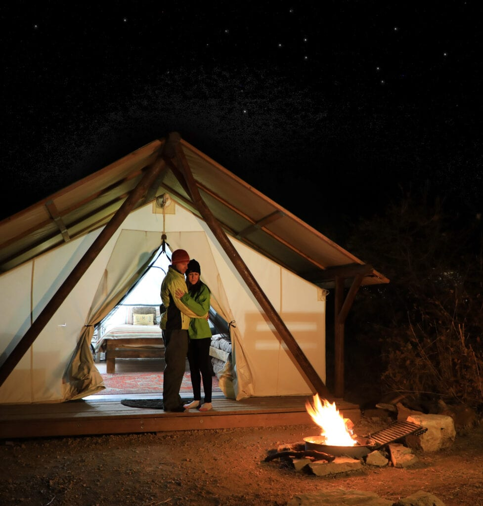 Couple glamping under the stars