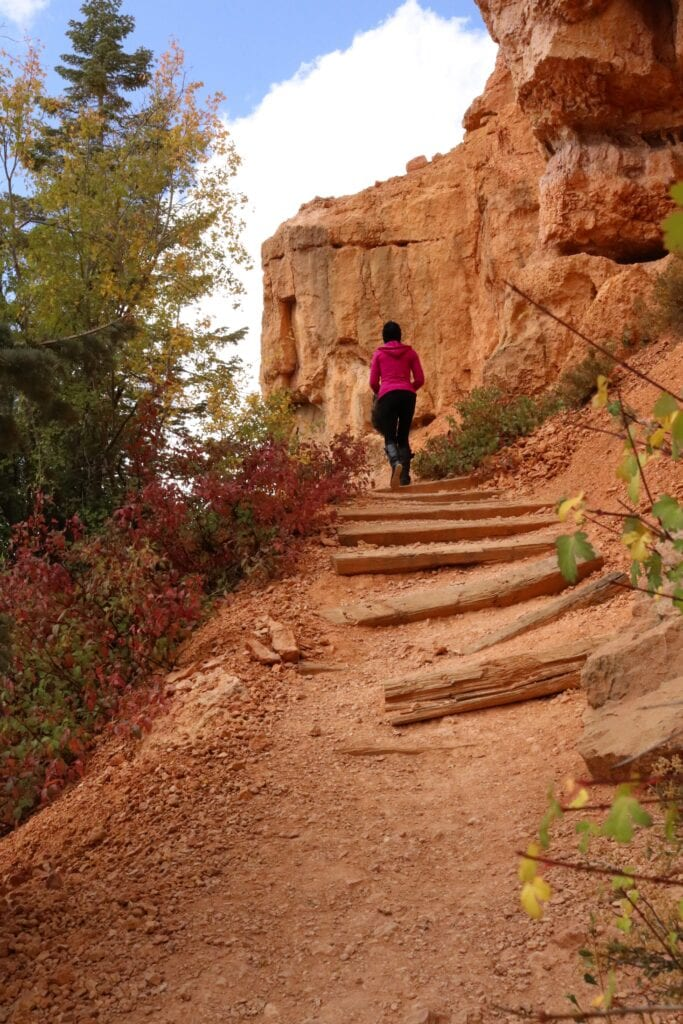girl climbing up steps in the mountains