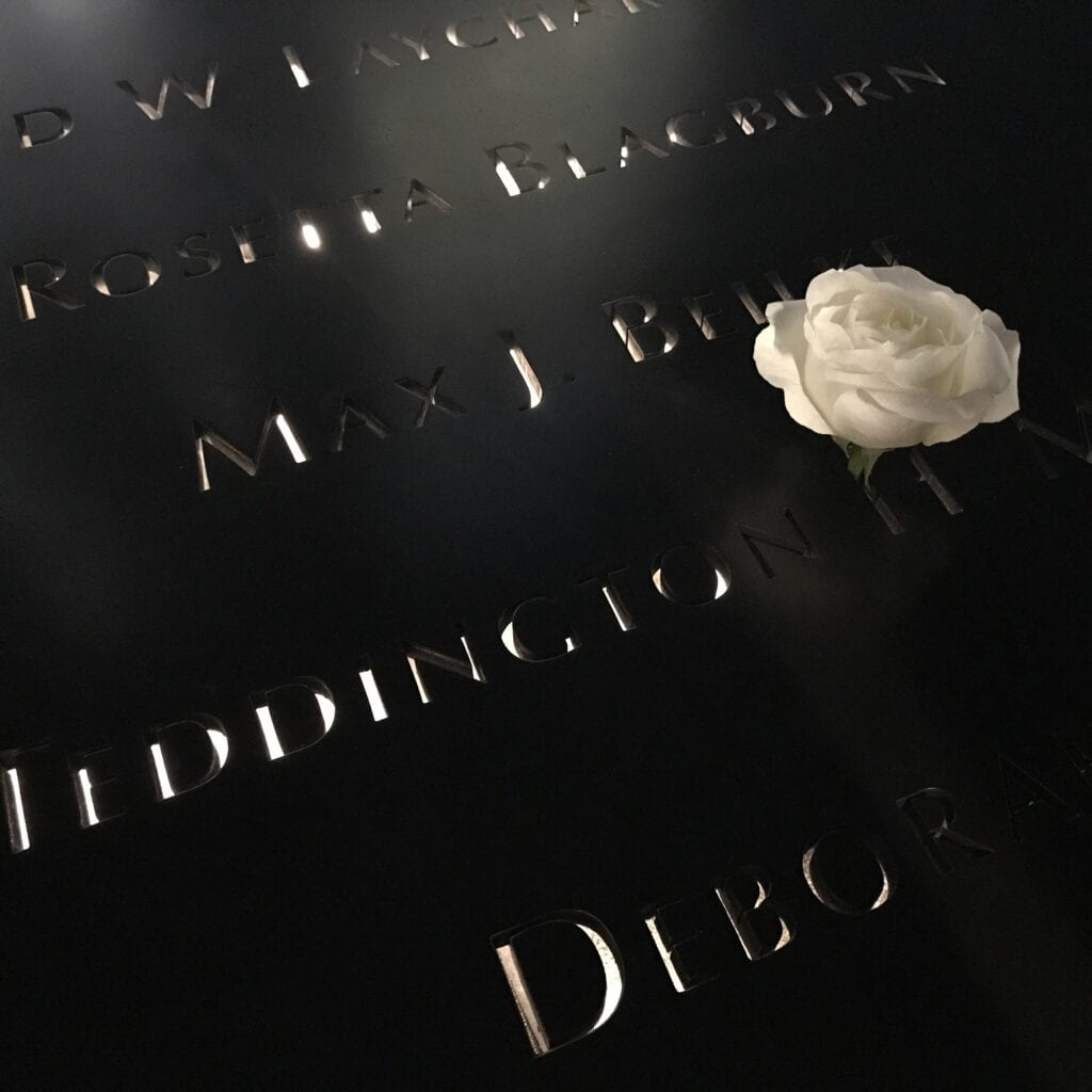 9/11 memorial names of the fallen lit-up at night New York