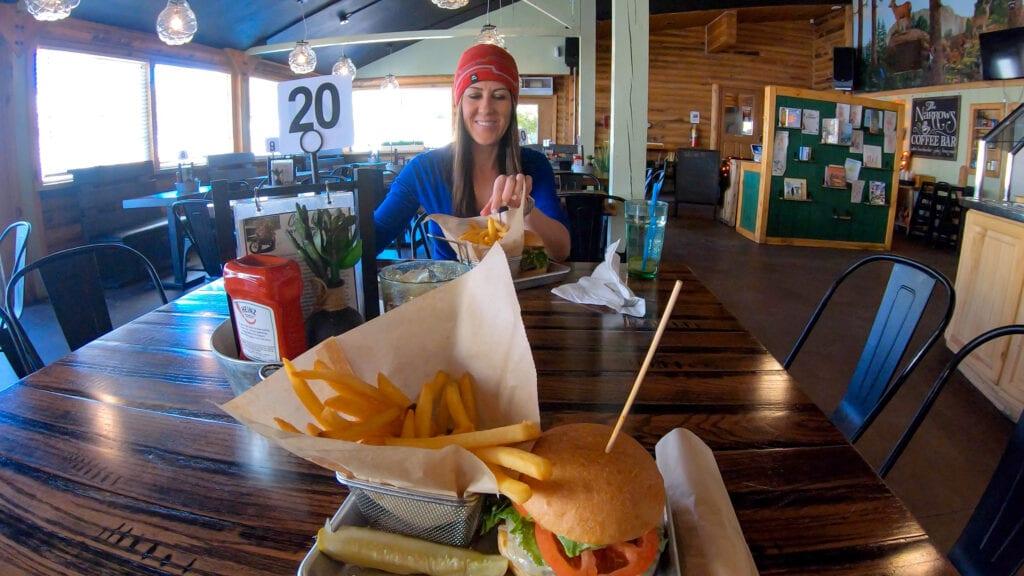 girl eating burger at Zion ponderosa