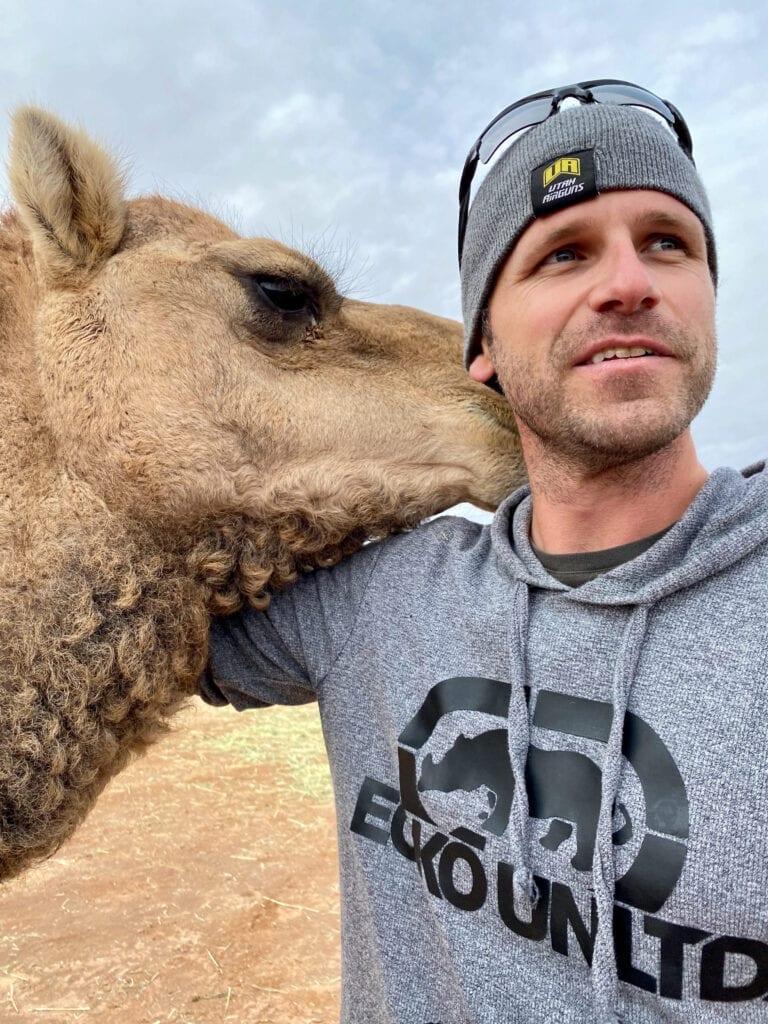 camel hugging man