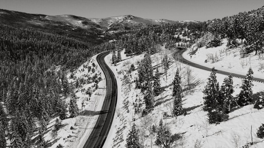 Seasonal depression. black and white drone photo of snow in the mountains