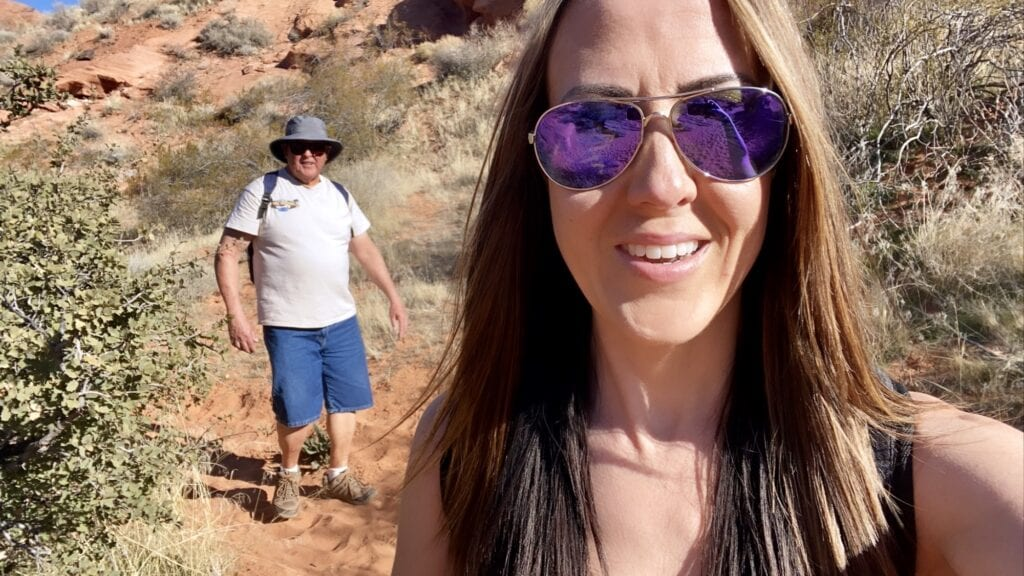 Girl and dad hiking elephant arch trail Utah